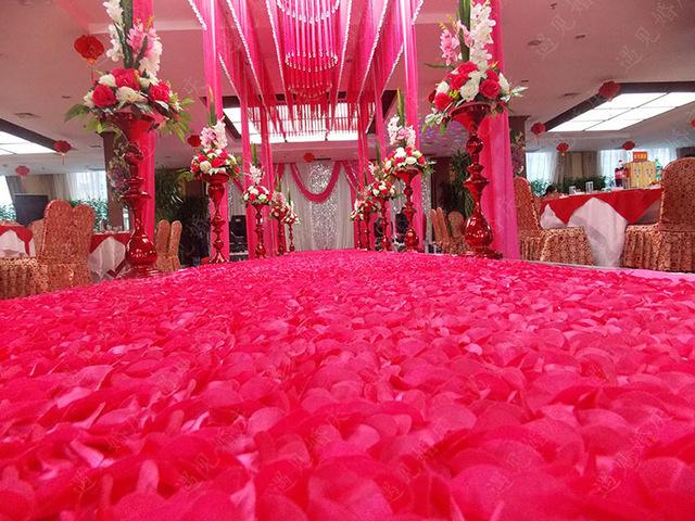 red rose petal wedding aisle
