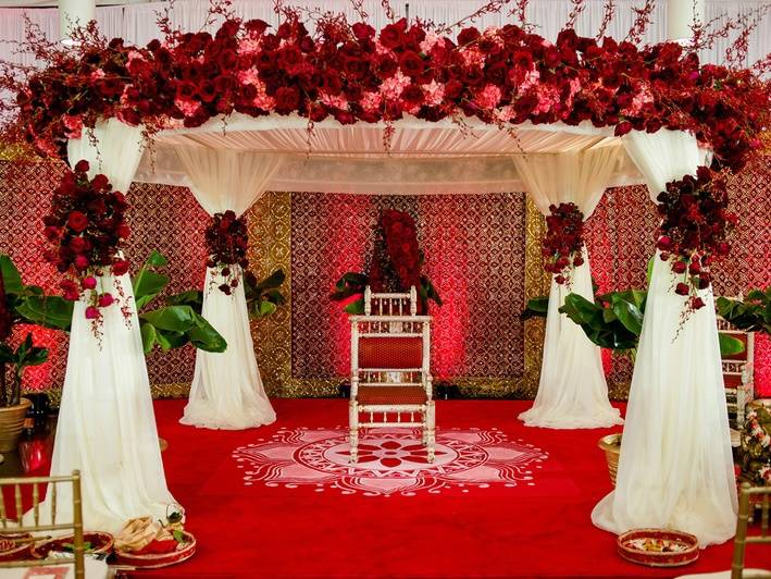 13 unique ideas that prove roses are the best wedding prop red rose floral mandap wedding prop junglespirit Images