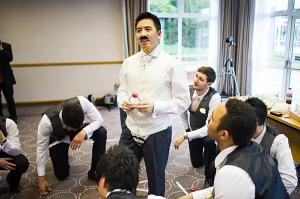 Groom participating in a wedding door game along with the groomsmen
