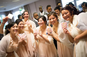 Bridesmaids showing off their money envelope they received from the groom