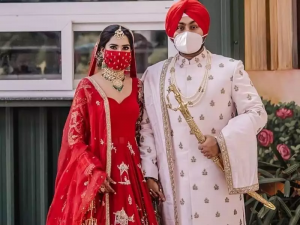 Bride and Groom wearing fancy customized mask matching to their attire
