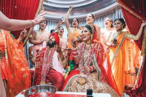 a grand indian wedding celebration with colours and laughter all around