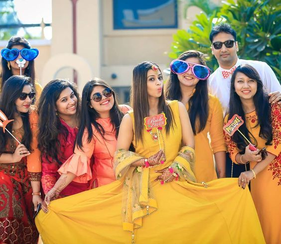 Haldi Poses with Friends